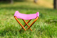 Folding camping stool in the park outdoor Stock Photo