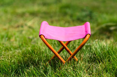 Folding camping stool in the park outdoor Royalty Free Stock Image