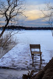 Folding chair on frozen lake Stock Photos