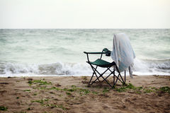 Folding chair on shore Stock Images