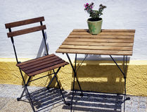 Folding chair and table Stock Images