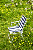 Folding chair under a blossoming tree Royalty Free Stock Images