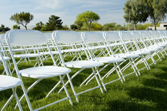Folding chairs 3. Folding chairs and stage set up for an outdoor college graduation ceremony Stock Photography