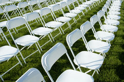 Folding chairs 4. Folding chairs and stage set up for an outdoor college graduation ceremony Royalty Free Stock Image