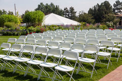 Folding Chairs at a Garden Wedding Stock Photo