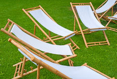 Folding chairs in a green park. Many folding chairs in a green park Royalty Free Stock Photo