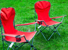 Folding chairs for outdoor recreation spring grass Stock Images