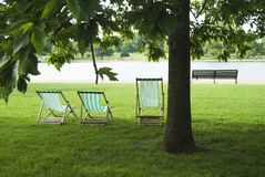 Folding chairs and park bench Stock Photos