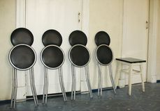 Folding chairs and stool Stock Images