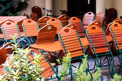 Folding chairs and tables at a beergarden.  Royalty Free Stock Images