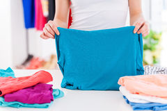 Folding clothes. Stock Images