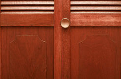 Folding closet door. Knob and panels of an old folding door Stock Photo