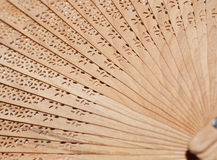 Folding fan background. Background with a close up  of wooden fan Royalty Free Stock Photo