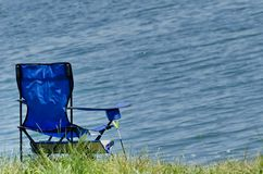 А folding fishing chair Stock Images