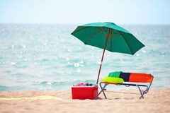 Folding furniture and ice box on summer beach Royalty Free Stock Photos