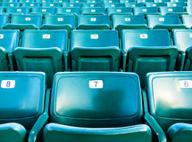 Folding green numbered  stadium seats Royalty Free Stock Image