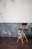 Folding high chair at the wall, vintage background Royalty Free Stock Photography
