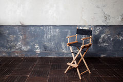 Folding high chair at the wall, vintage background Royalty Free Stock Images