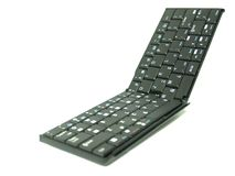Folding Keyboard 02. Folding portable keybord over white background Stock Photography