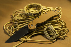 Folding knife on paracord. With paracord  bracelet and plastic carabineer Royalty Free Stock Photography