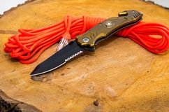 Folding knife with stap cut and cullet. Parachute cord. stock images
