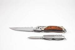 Folding knives on a white background Royalty Free Stock Images