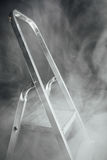 Folding ladder in smoke Stock Photos