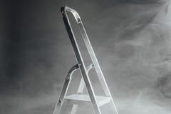 Folding ladder in smoke Stock Image