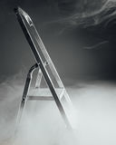 Folding ladder in smoke Stock Photos