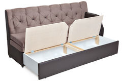 Folding light brown fabric sofa bed with storage. stock photography