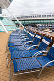 Folding lounge chairs on a ship Stock Images