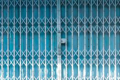 Free Folding Metal House Door, Old Metallic, Iron Door. Blue Stretched Slide Steel Airy Door At Outside With Steel Sheet Lock And Dense Stock Photo - 161279000