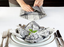 Folding napkins for dinner Stock Photo