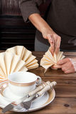 Folding napkins for lunch Stock Photos