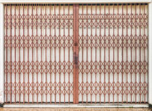 Folding old red metal door gate Stock Photos