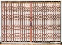 Folding old red metal door gate Stock Photos