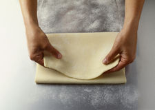 Folding the pastry. Food, gastronomy,culinary,cookery Royalty Free Stock Photos