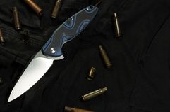Folding pocket knife and sleeves. Cartridge and gun sleeves royalty free stock photos