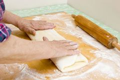 Folding and rolling dough (Recipe Series) Royalty Free Stock Images