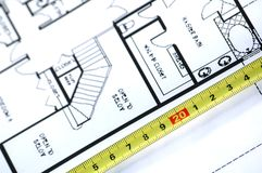 Folding rule and architectural plan. House plans and folding rule , concept of home architecture Royalty Free Stock Image