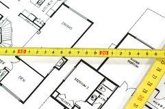 Folding rule and architectural plan. House plans and folding rule , concept of home architecture Royalty Free Stock Photography