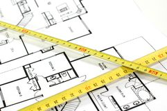 Folding rule and architectural plan. House plans and folding rule , concept of home architecture Stock Image