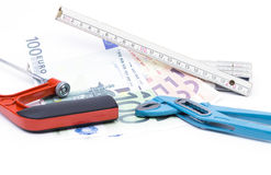 Folding rule with money and tools Stock Photo