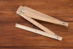 Folding rule on wood Royalty Free Stock Photos