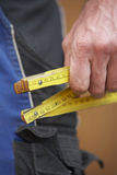 Folding ruler. Close up of a folding ruler in the hand of a worker royalty free stock image