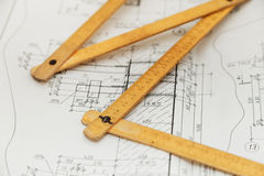 Folding ruler on engineer drawing designs Royalty Free Stock Photo