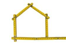 Folding ruler - house shape. White background royalty free stock photography