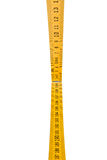 Folding ruler isolated, yellow carpenter`s rule with centimeters numbers. Stock Photo