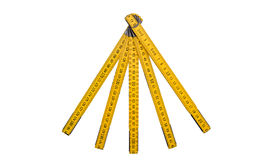 Folding ruler isolated, yellow carpenter`s rule with centimeters numbers. Royalty Free Stock Photos