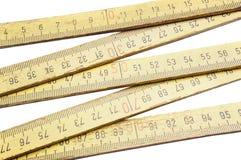 Folding ruler on white background Stock Photos